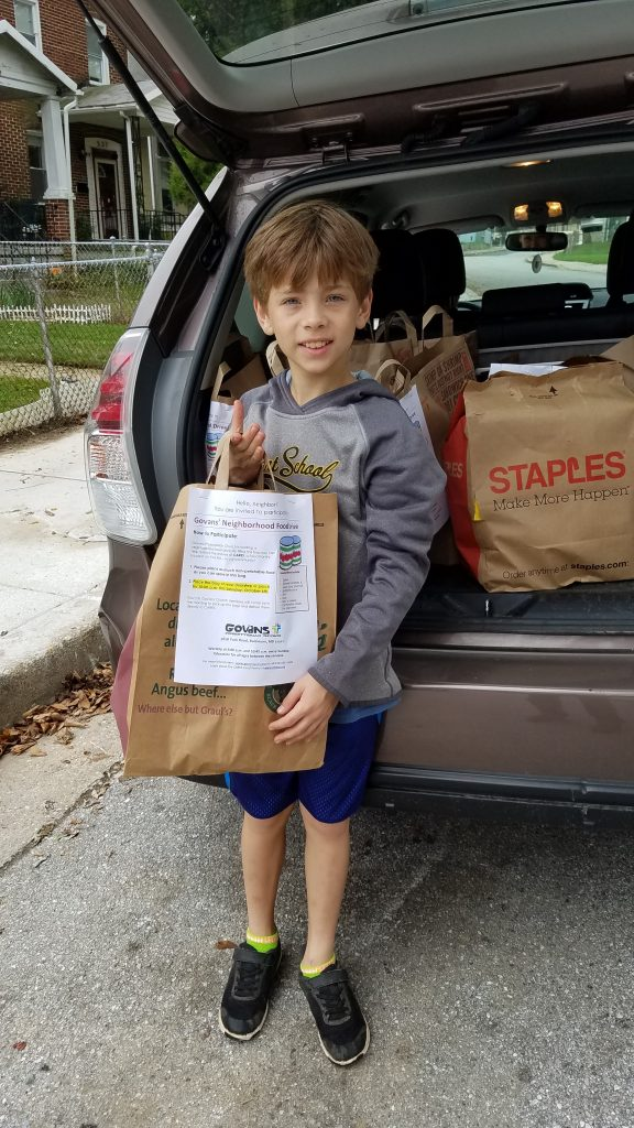 Packing the car for Govans' Neighborhood Food Drive